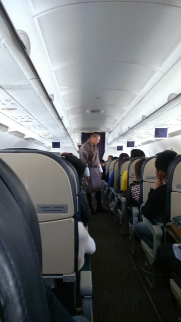 Prime Minister, Tshering Tobgay Greeting All Passengers in the Airplane