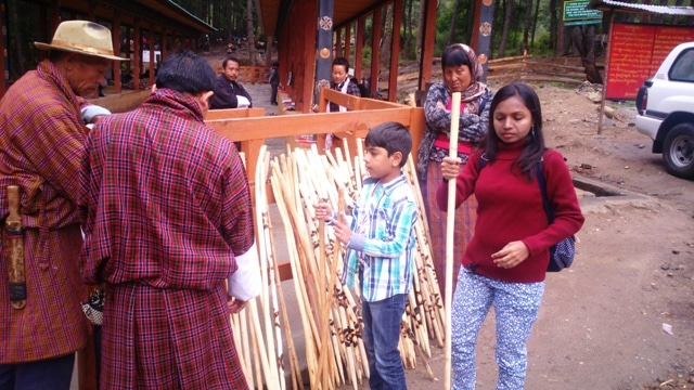 Selecting our sticks for the trek